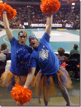 Cheerleaders wearing Sockit Wenches colors of blue and orange at the Derby