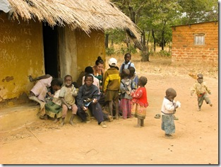 kids and meg with brace outside hut